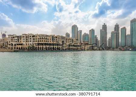 Dubai, United Arab Emirates - Dec 2, 2014: Panorama view of the Comercial Center Souk Al Bahar, near the highest building in the world, burj Khalifa with a pond were worlds largest fountain show is - stock photo