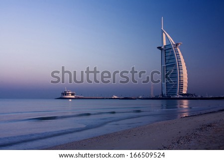"DUBAI, UNITED ARAB EMIRATES - DECEMBER 18: A general view of the world's first seven stars luxury hotel Burj Al Arab ""Tower of the Arabs"", also known as ""Arab Sail"" on December 18, 2009 in Dubai, UAE - stock photo"