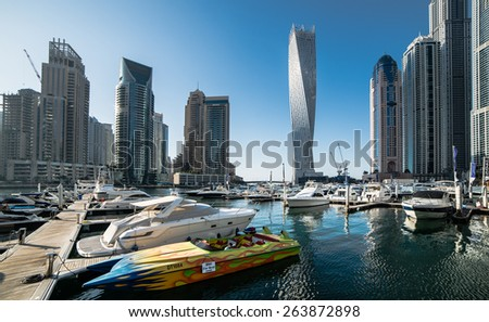 Dubai, United Arab Emirates - December 14, 2013:  Panoramic view with modern skyscrapers and water pier of Dubai Marina, United Arab Emirates - stock photo