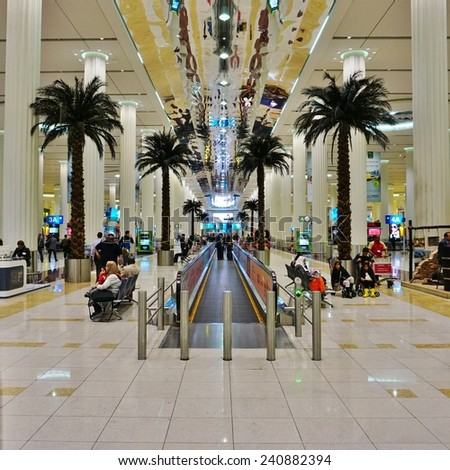 DUBAI, UNITED ARAB EMIRATES -- DECEMBER 2014-- The Dubai International Airport (DXB) is the main airline hub in the Middle East. Employing about 90,000 people, it is home notably to Emirates airlines. - stock photo