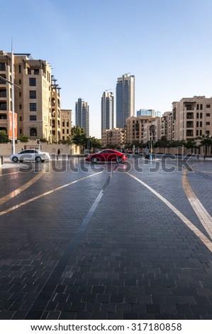 Dubai, United Arab Emirates - Feb 23, 2012: View of Emaar district, downtown Dubai on February 23rd. The district hosts some of the most famous landmarks of Dubai; Burj Khalifa, Dubai Mall etc. - stock photo