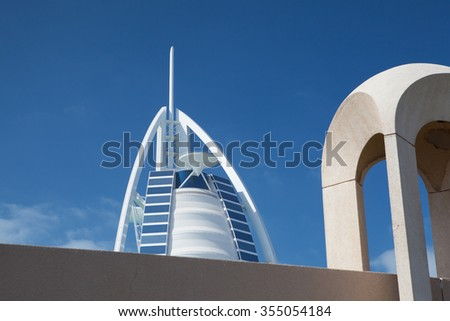 Dubai,United Arab Emirates - February 3,2012:Burj Al Arab hotel - hotel is classed as one of the most luxurious in the world, built on an artificial island in front of Jumeirah beach. - stock photo