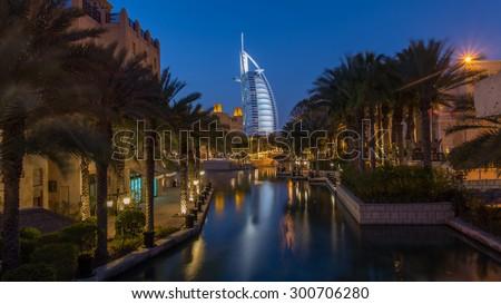 DUBAI, UNITED ARAB EMIRATES- FEBRUARY 22, 2014: Burj Al Arabe hotel from Souk Madinat Jumeirah - stock photo
