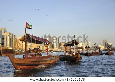 DUBAI, UNITED ARAB EMIRATES - FEBRUARY 8, 2014: Dubai, United Arab Emirates -  An 'Abra' or water-taxi carries passengers across the creek in Dubai , February 8, 2014 Dubai, United Arab Emirates  - stock photo