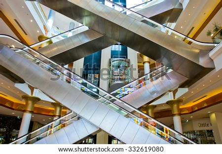 Dubai, United Arab Emirates - February 18 2007: The escalators of the Wafy City Mall - stock photo