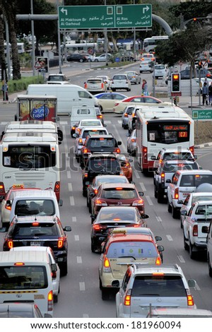 DUBAI, UNITED ARAB EMIRATES - FEBRUARY 9, 2014: Traffic on highway leading to city center. During rush hour highways and roads are full with traffic. February 9, 2014 Dubai, United Arab Emirates      - stock photo