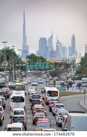 DUBAI, UNITED ARAB EMIRATES - FEBRUARY 9, 2014: Traffic on highway  to the city center. During rush hour all highways  are full with traffic. February 9, 2014 Dubai, United Arab Emirates      - stock photo