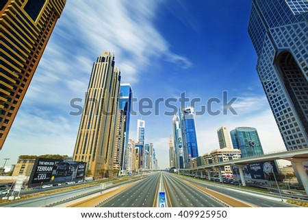 DUBAI, UNITED ARAB EMIRATES - FEBRUARY 28, 2016: View on modern skyscrapers in luxury Dubai architecture and Shaek Zayed road in the middle,Dubai,United Arab Emirates
