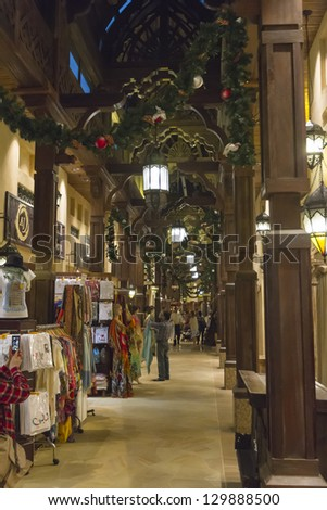 DUBAI, UNITED ARAB EMIRATES - JANUARY 9: The Madinat Souk at Madinat Jumeirah Hotel. Some restaurants and shops in the souk. Some people are walking and watching shops on January 9, 2013 in Dubai
