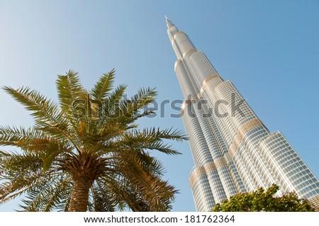 DUBAI, UNITED ARAB EMIRATES - 10 JUNE, 2013: Burj Khalifa tower. This skyscraper is the tallest man-made structure in the world, measuring 828 m. Completed in 2009. June 10, 2013 Dubai, UAE - stock photo
