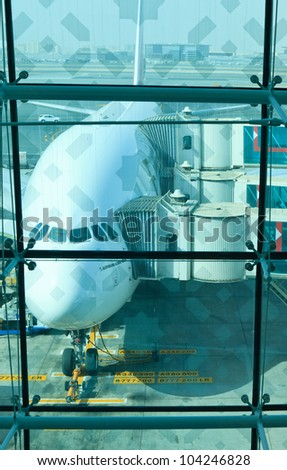 DUBAI, UNITED ARAB EMIRATES - JUNE 2: Emirates Airlines Airbus A380 docked at Dubai International Airport on June 2, 2012 in Dubai, UAE. Emirates was first customer to place order for the a380. - stock photo