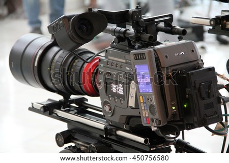 DUBAI, UNITED ARAB EMIRATES -- MARCH 25, 2013: A professional Sony video camera is being used to film an outdoor video project.
