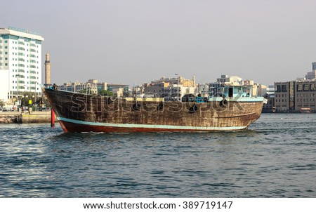 Dubai, United Arab Emirates - March 11, 2016 : Traditional Abra (water taxi) crossing the Dubai Creek between Deira and Bur Dubai