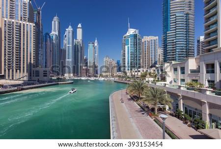 DUBAI, UNITED ARAB EMIRATES - MARCH 2, 2016: View on promenade at the sunny day in Dubai Marina in Dubai,Dubai,United Arab Emirates - stock photo