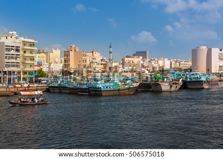 DUBAI, UNITED ARAB EMIRATES - MARCH 1, 2016: Water taxi and old wooden boats in Deira city,Dubai,United Arab Emirates