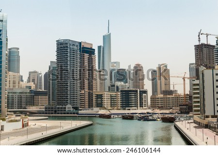 DUBAI, UNITED ARAB EMIRATES - MAY 3: Skyscrapers along Sheikh Zayed Road in Dubai on May 3, 2012. Its a skyscraper areal in Dubai that contains for example  the Emirates Office Tower&Hotel. - stock photo