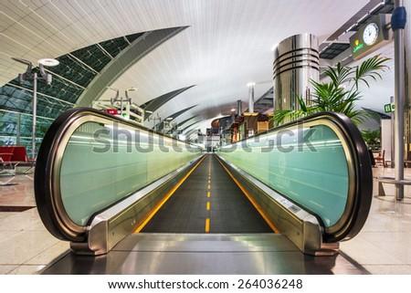 DUBAI, UNITED ARAB EMIRATES - NOVEMBER 7, 2009: Futuristic interior of international airport of Dubai. Dubai airport has a maximum capacity of 60 million passengers, 2.1 million tons of cargo per year - stock photo