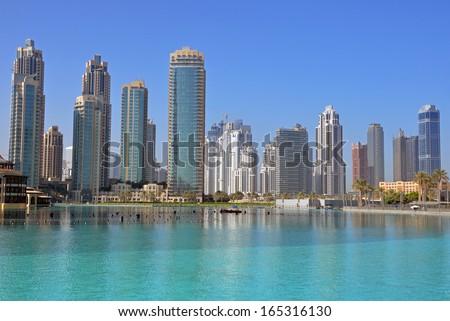 DUBAI, UNITED ARAB EMIRATES -Â?Â? OCTOBER 20: Burj Khalifa Lake on October 20, 2013 in Dubai, United Arab Emirates.Burj Khalifa Lake is a man-made lake which is in Downtown Dubai. - stock photo