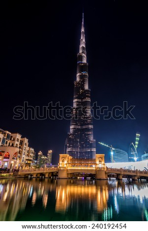 DUBAI, UNITED ARAB EMIRATES - 21 OCTOBER, 2014: Burj Khalifa tower. This skyscraper is the tallest man-made structure in the world, measuring 828 m.  - stock photo
