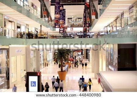 DUBAI, UNITED ARAB EMIRATES - October 17: People walking inside Dubai Mall. it is the world's largest shopping mall., October 17 , 2013 in Dubai. - stock photo