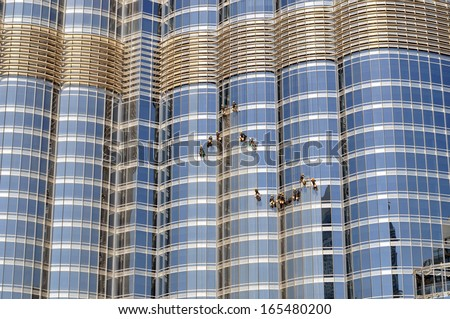 DUBAI, UNITED ARAB EMIRATES � OCTOBER 20: Window cleaners at Burj Khalifa on October 20, 2013 in Dubai, United Arab Emirates.Burj Khalifa is 828 meters high and was opened in 2010. - stock photo