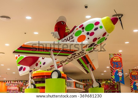 DUBAI, UNITED ARAB EMIRATES - SEPTEMBER 7, 2015: Interior of Dubai Mall - world's largest shopping mall based on total area and sixth largest by gross leasable area. Candy shop. - stock photo