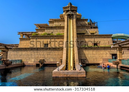 DUBAI, UNITED ARAB EMIRATES - SEPTEMBER 7, 2015: The Aquaventure waterpark of Atlantis the Palm hotel, located on man-made island Palm Jumeirah. The Tower Of Neptune. - stock photo