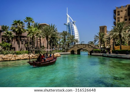 DUBAI, UNITED ARAB EMIRATES - SEPTEMBER 10, 2015: View of Burj Al Arab hotel from Madinat Jumeirah hotel. Madinat is a luxury resort which includes hotels and souk covering an area over 40 hectars. - stock photo