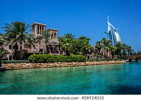 DUBAI, UNITED ARAB EMIRATES - SEPTEMBER 10, 2015: View of luxury 5 stars Madinat Jumeirah hotel - largest resort in emirate (40 hectares of landscapes and gardens) with own artificial canals.  - stock photo
