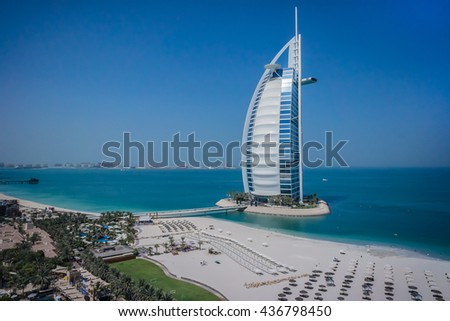 DUBAI, UNITED ARAB EMIRATES - SEPTEMBER 7, 2015: World's most luxurious hotel Burj Al Arab, on an artificial island, 280m from Jumeirah beach - one of the main attractions of Dubai.