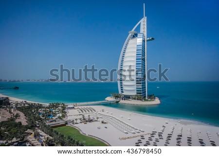 DUBAI, UNITED ARAB EMIRATES - SEPTEMBER 7, 2015: World's most luxurious hotel Burj Al Arab, on an artificial island, 280m from Jumeirah beach - one of the main attractions of Dubai. - stock photo