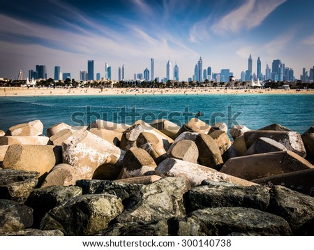 DUBAI, UNITED ARAB EMIRATES (UAE) - JAN 24, 2014: Jumeirah Beach and city skyline of Dubai, United Arab Emirates - stock photo