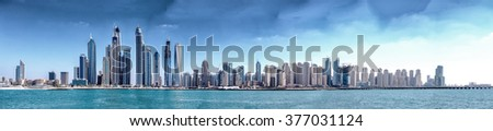 DUBAI, UNITED EMIRATES - NOVEMBER 22, 2015: Modern skyline of Dubai on a beautiful sunny day. The city is expanding more and more every year. - stock photo