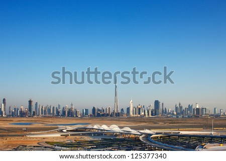 Dubai was just a desert 30 years ago, now it is home to many of the tallest skyscrapers in the world - stock photo