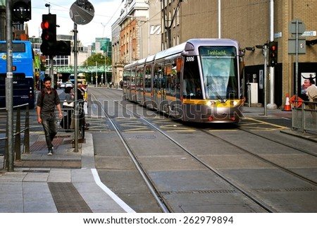 DUBLIN, EIRE - MARCH 23. The new Dublin tram system is a fast and reliable modern transport system linking central city shopping Henry Street and Grafton Street. March 23, 2015 in Dublin, Eire. - stock photo