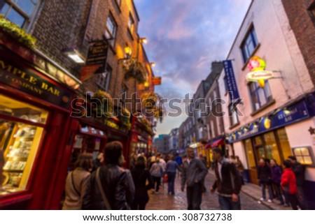 DUBLIN, IRELAND - APRIL 17, 2011: Blurred defocused illuminated. Many people spend their nightlife around the popular historical landmark of Dublin - Temple Bar district on April 17, 2011. - stock photo