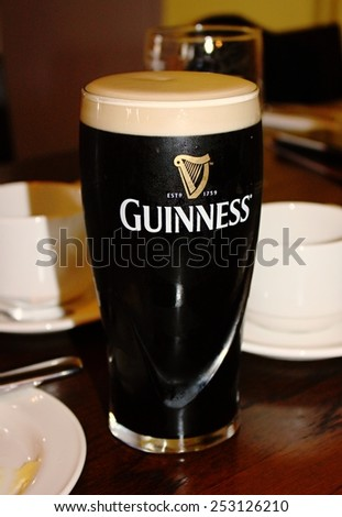 DUBLIN, IRELAND - APRIL28, 2014: Pint of beer served at Guinness Brewery on April 28, 2014 in Dublin. Brewery where 2.5 million pints of stout are brewed daily was founded by Arthur Guinness in 1759 - stock photo
