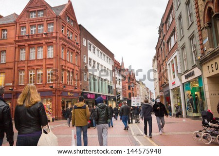 DUBLIN, IRELAND - APRIL 1: View of Grafton Street in Dublin Ireland on April 1, 2013.  Pedestrian friendly Grafton St. is a landmark shopping district in Dublin. - stock photo