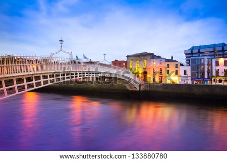 Dublin Ireland at dusk with waterfront and historic Ha'penny Bridge