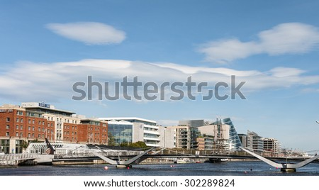 Dublin, Ireland - Aug 1, 2015: The Samuel Beckett Bridge crosses the Liffey River in Dublin. The structure, designed with a cable-stay method of suspension, is said to resemble an Irish harp. - stock photo