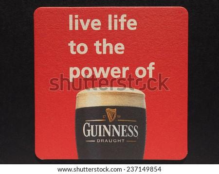 DUBLIN, IRELAND - DECEMBER 11, 2014: Beermat of Irish beer Guinness - stock photo