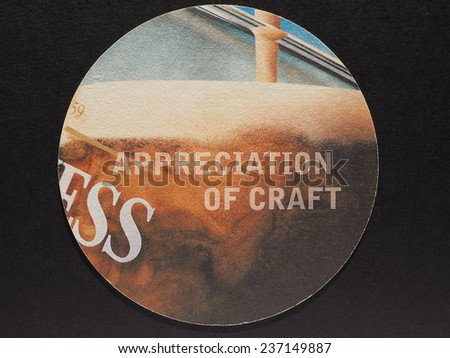 DUBLIN, IRELAND - DECEMBER 11, 2014: Beermat of Irish beer Guinness