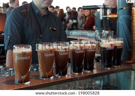 DUBLIN, IRELAND - FEB 15, 2014: Pints of beer are served at the Guinness Brewery on Feb 15, 2014. The brewery where 2.5 million pints of stout are brewed daily was founded by Arthur Guinness in 1759. - stock photo