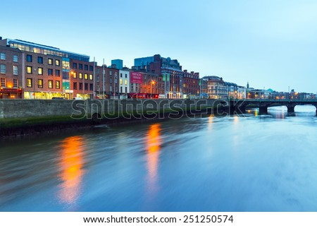 DUBLIN, IRELAND - FEBRUARY 20, 2012: Architecture of city centre at Liffey river in Dublin, Ireland. Dublin is the capital and largest city located on the east coast of Ireland. - stock photo