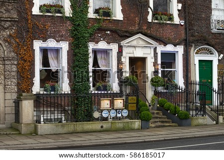 Dublin, Ireland - February 14, 2017: Contemporary fine dining restaurant in a Georgian townhouse covered with green ivy