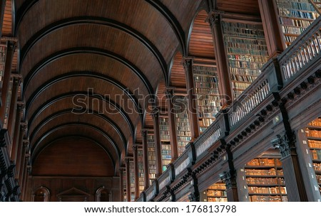 DUBLIN, IRELAND - JULY 27: The Long Room in the Trinity College Library on July 27, 2013 in Dublin, Ireland. Trinity College Library is the largest library in Ireland and home to The Book of Kells. - stock photo