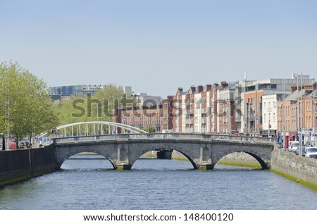 DUBLIN, IRELAND - JUNE 7: Mellows Bridge and River Liffey, Dublin, Ireland on June 7, 2013