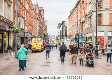 DUBLIN, IRELAND - MAY 6, 2016: People walking in the Henry Street. The pedestrian street is famous for its artists, restaurants and more than 200 shops.