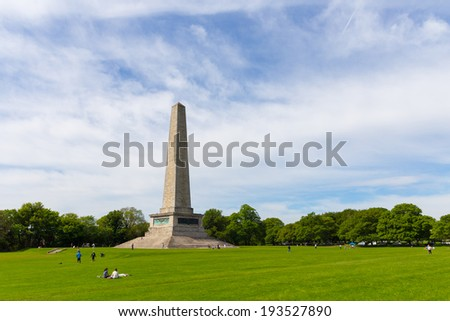 DUBLIN, IRELAND - MAY 17, 2014: The Wellington Monument is an obelisk located in the Phoenix Park. The monument is 62 metres (203 ft) tall and it is the largest obelisk in Europe. - stock photo
