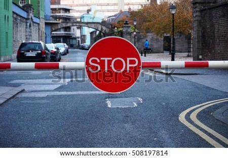 DUBLIN, IRELAND -1 NOV 2016- A red stop sign on a barrier blocks the entrance to the Dublin Castle.